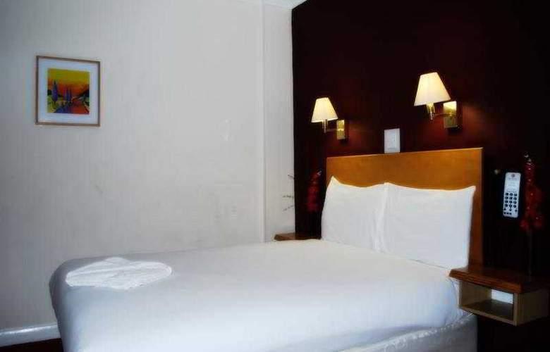 Skyplaza Hotel - Room - 4