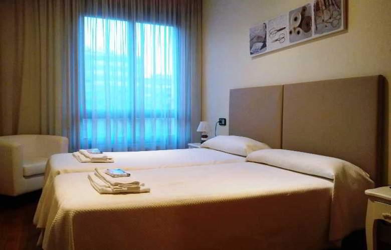 Apartamentos Gestion de Alojamientos - Room - 19