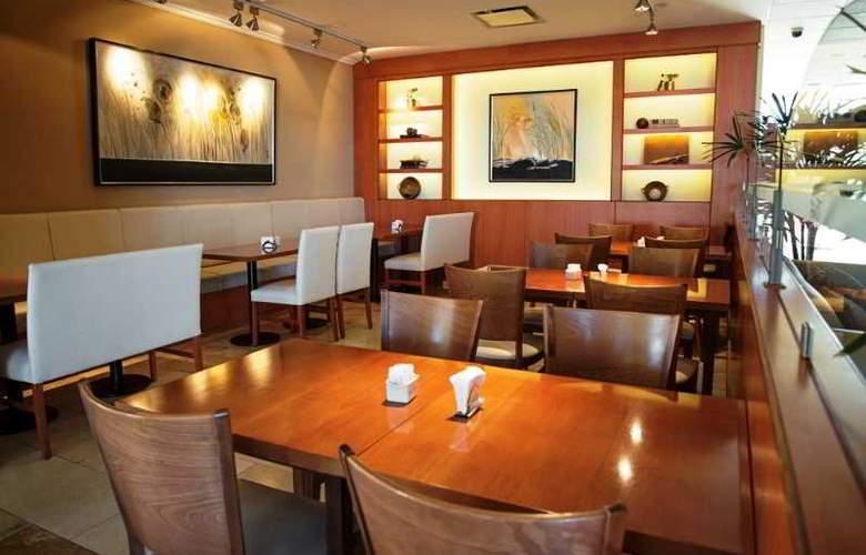 Tower &  Inn Suites - Restaurant - 9