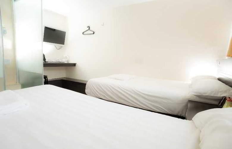 Homy Inn - Room - 12