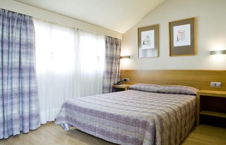 Hostal El Pasaje - Room - 1