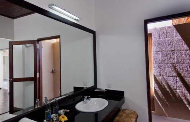 Adi Assri Beach Cottages Singaraja - Room - 18