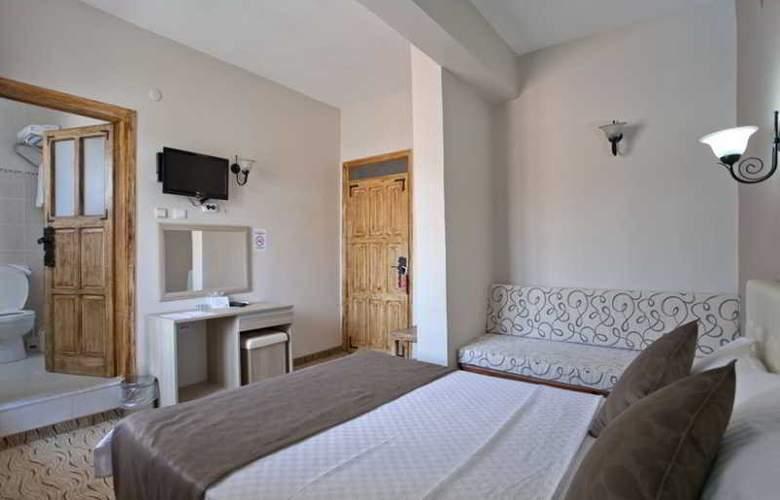 Yasemin Hotel - Room - 8
