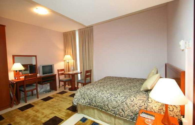 Jormand Hotel Apartments Sharjah - Room - 2