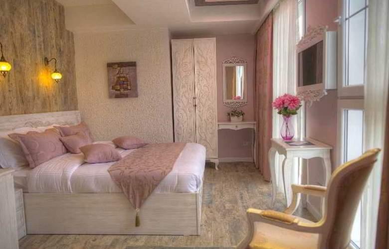 Elegance Asia Hotel - Room - 14