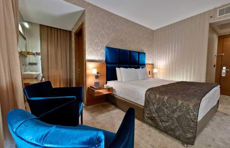 Riva Resatbey Boutique & Busines Hotel - Room - 4