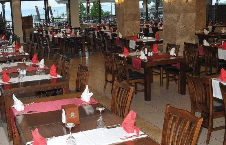 Crystal Flora Beach Resort - Restaurant - 8