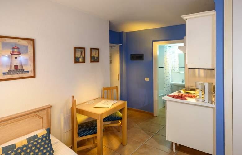 Oro Blanco Apartments - Room - 12