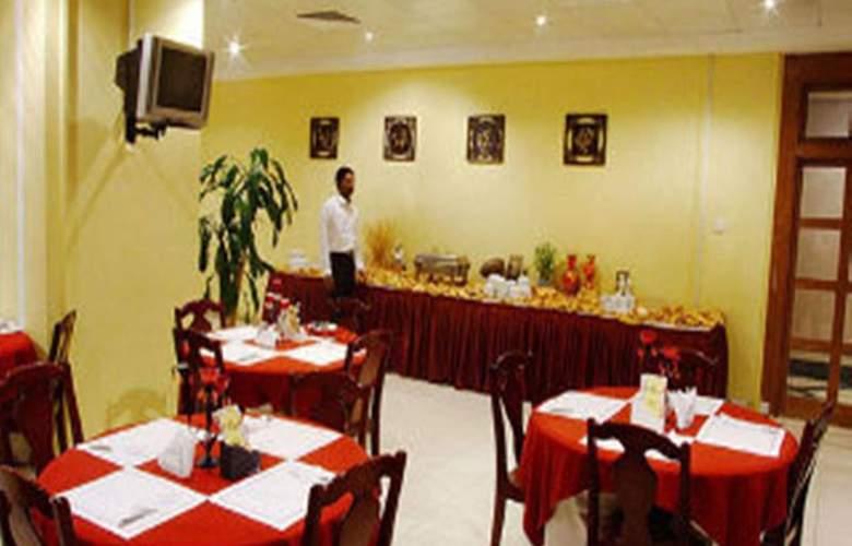 Oasis Court Hotel Apartment - Restaurant - 12