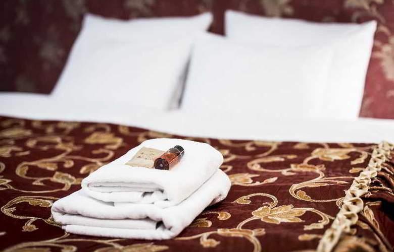 Abella Suites & Apartments - Room - 11