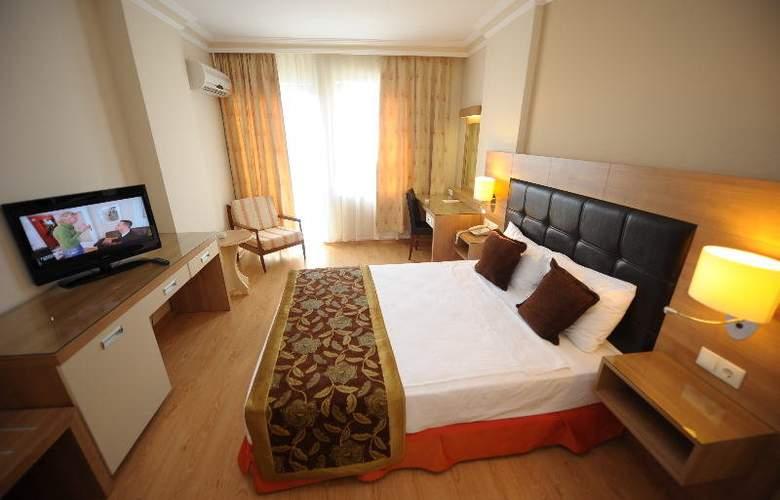 Suite Laguna Apart & Hotel - Room - 10