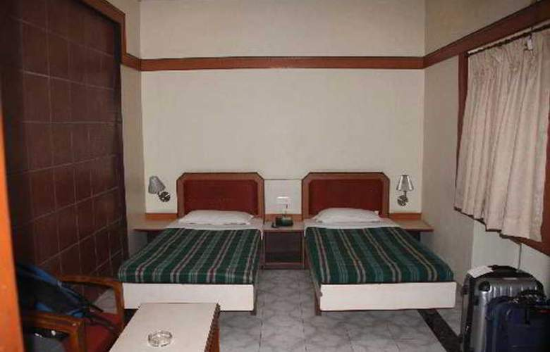 Pallavi International Hotel - Room - 4
