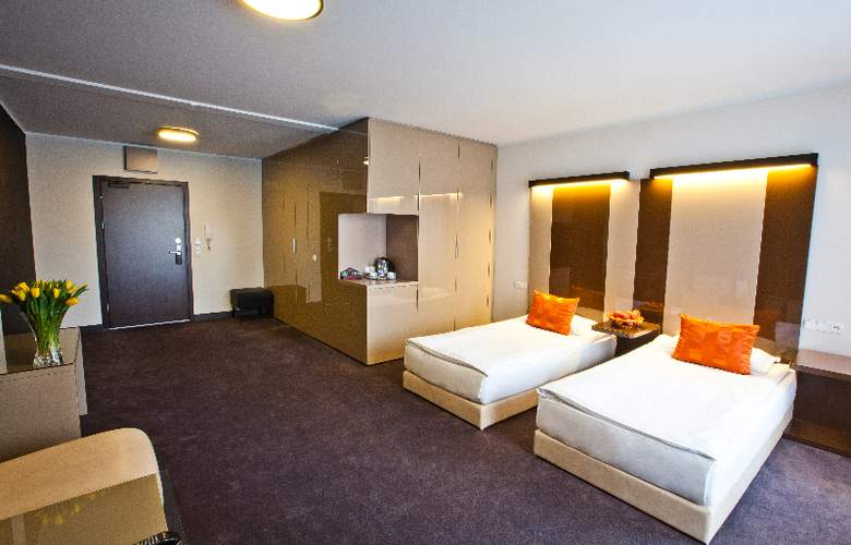 Platinum Palace Serviced Apartments Poznan - Room - 9