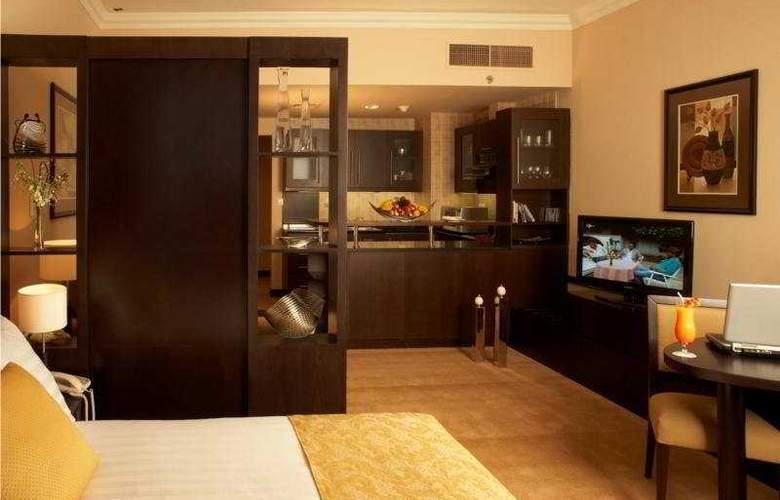 Al Manzel Hotel Apartments - Room - 4