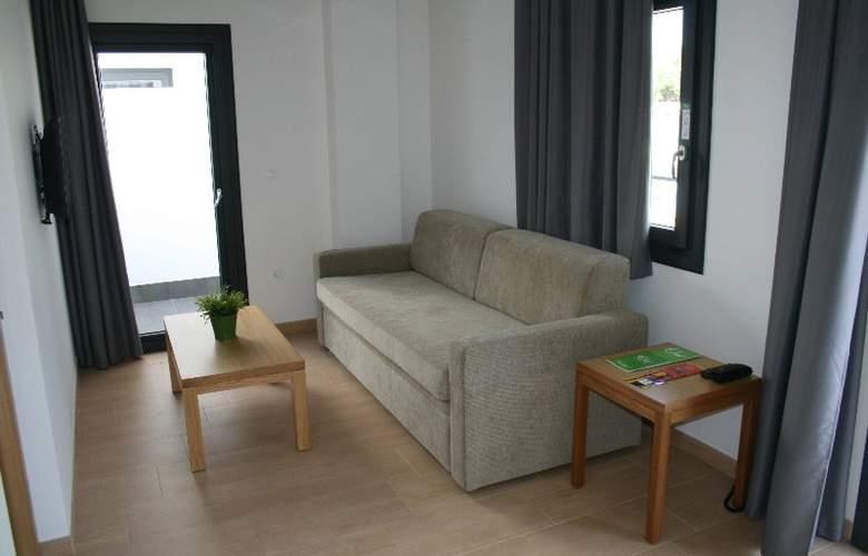 Al Sur Apartamentos Turísticos - Room - 2