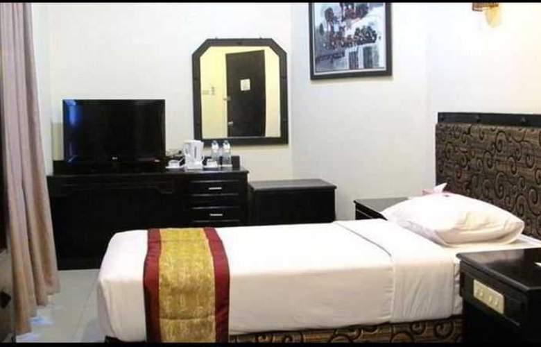 Gaja Hotel Pekanbaru - Room - 9