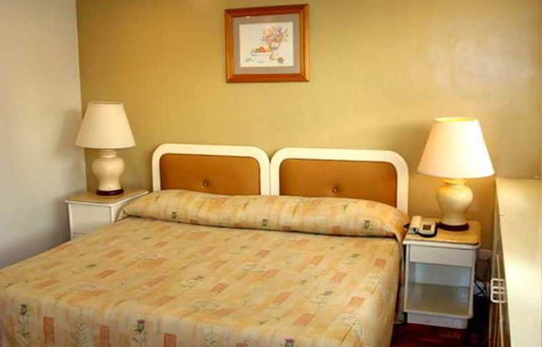 Lourdes Suites - Room - 8