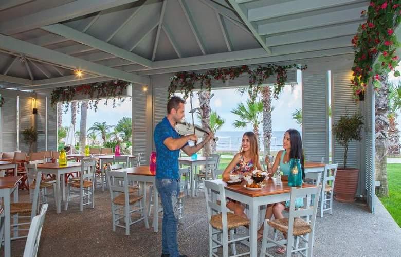 Aquamare Beach Hotel & Spa - Bar - 16
