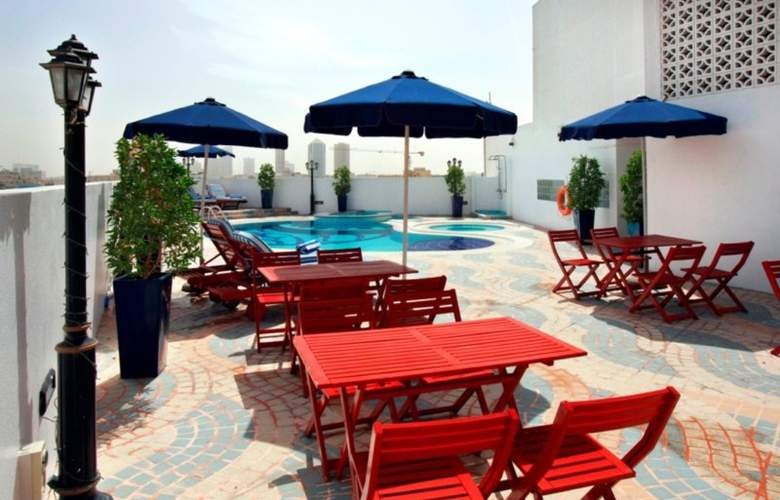 Howard Johnson Hotel Bur Dubai - Pool - 11