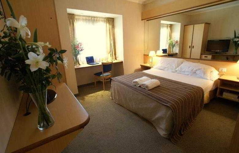 Aeroparque Inn & Suites - Room - 4