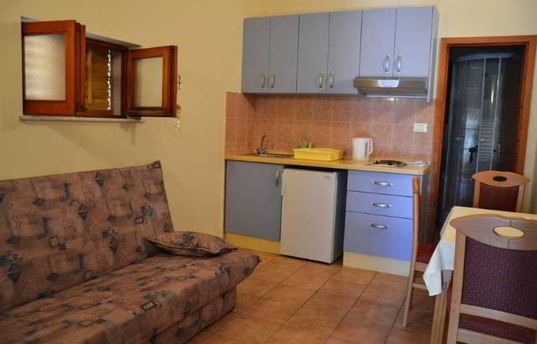 Luce Apartments - Room - 1