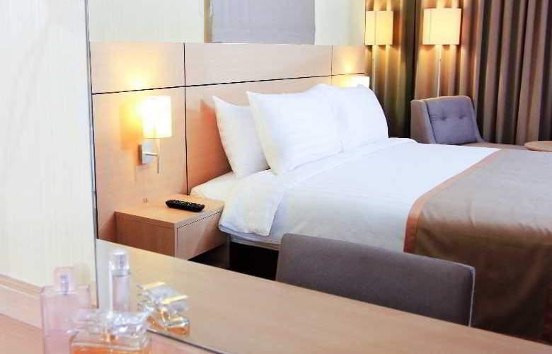 Petals Inn - Room - 11
