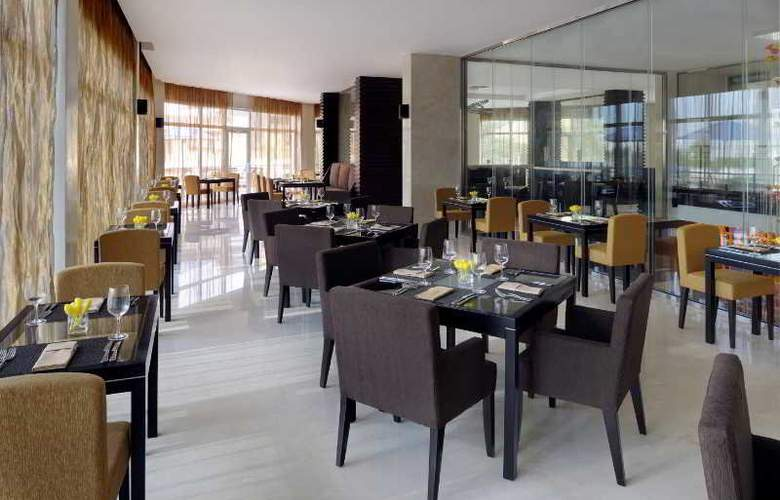 Movenpick Hotel Jumeirah Lakes Towers - Restaurant - 4