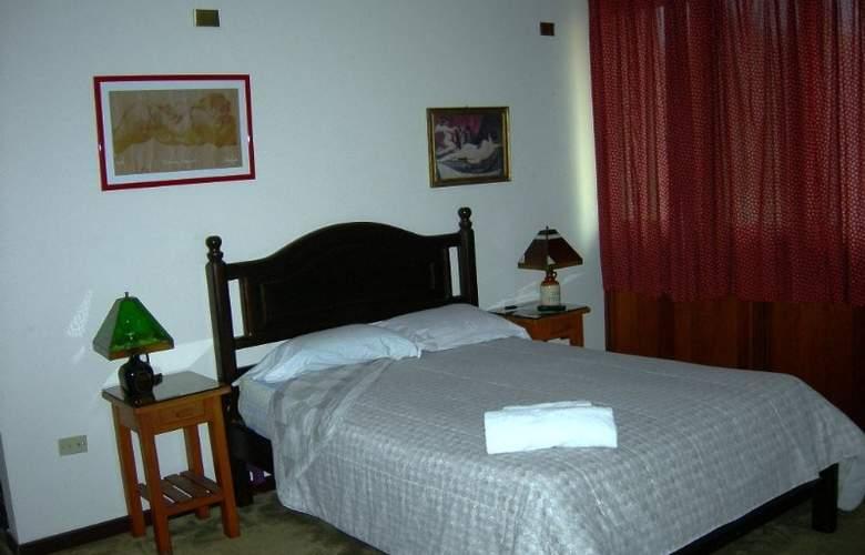 Casa Internacional Los Aventureros - Room - 19