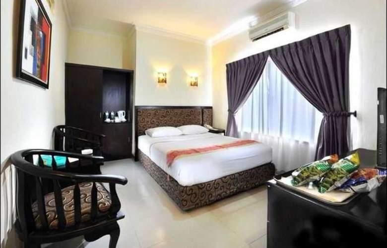 Gaja Hotel Pekanbaru - Room - 8