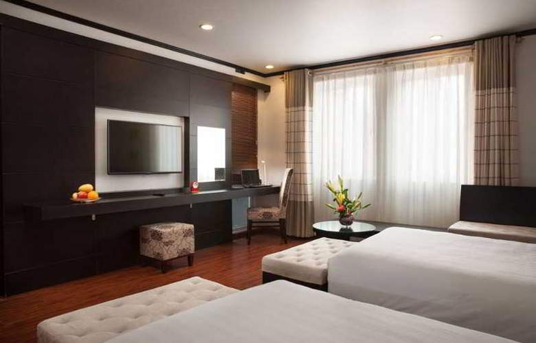 Boss Legend Hotel - Room - 9