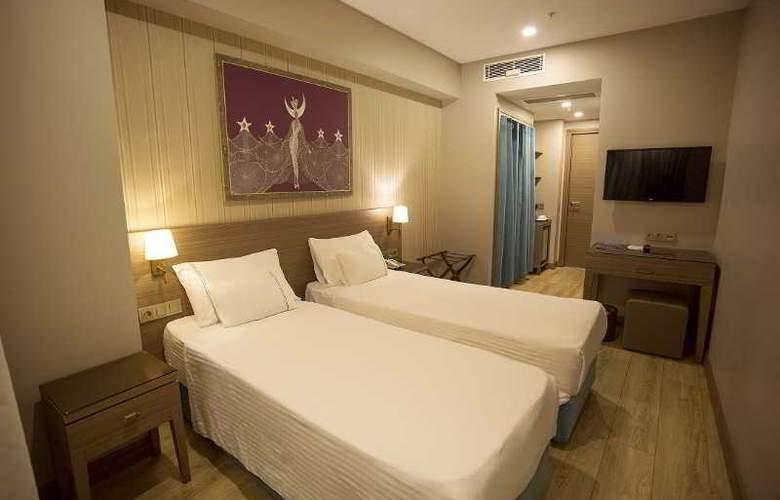 Taximist Hotel - Room - 2