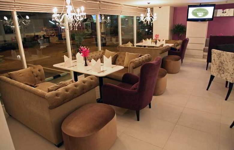 Nova Suites - Restaurant - 17