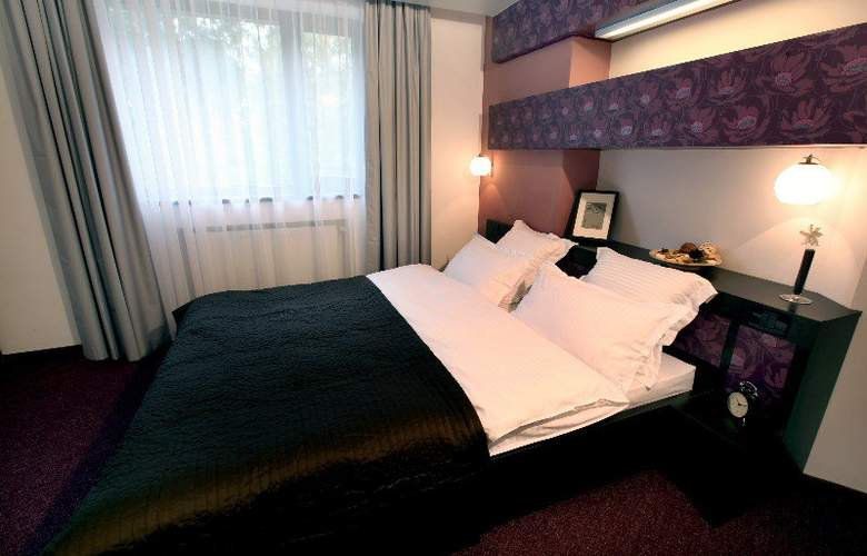 Ambiance Hotel - Room - 2