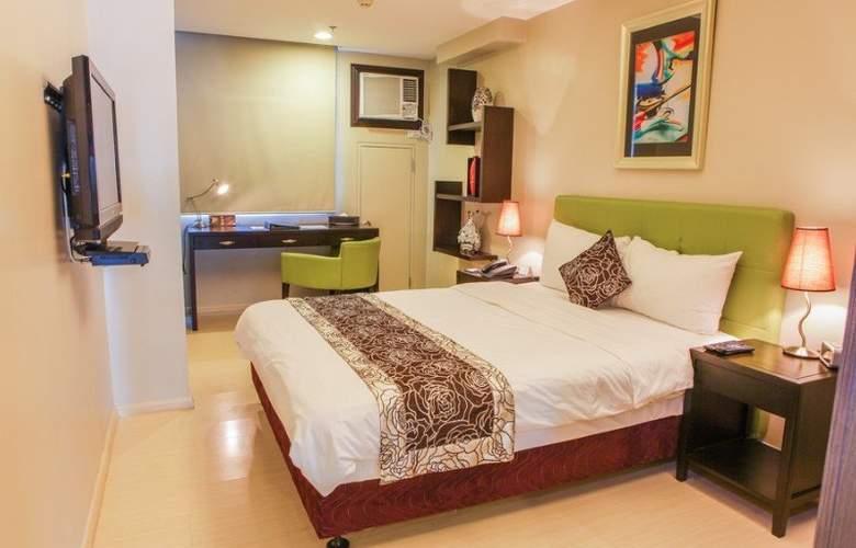 The Exchange Regency Residence Hotel - Room - 11
