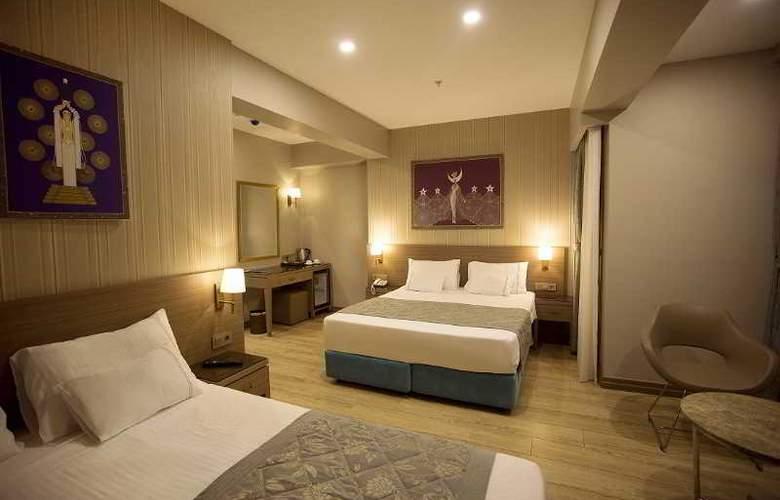 Taximist Hotel - Room - 4