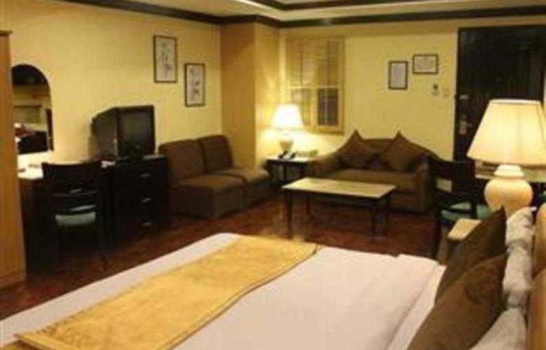 Lourdes Suites - Room - 10