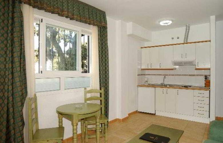 Apartamentos La Fonda - Room - 2