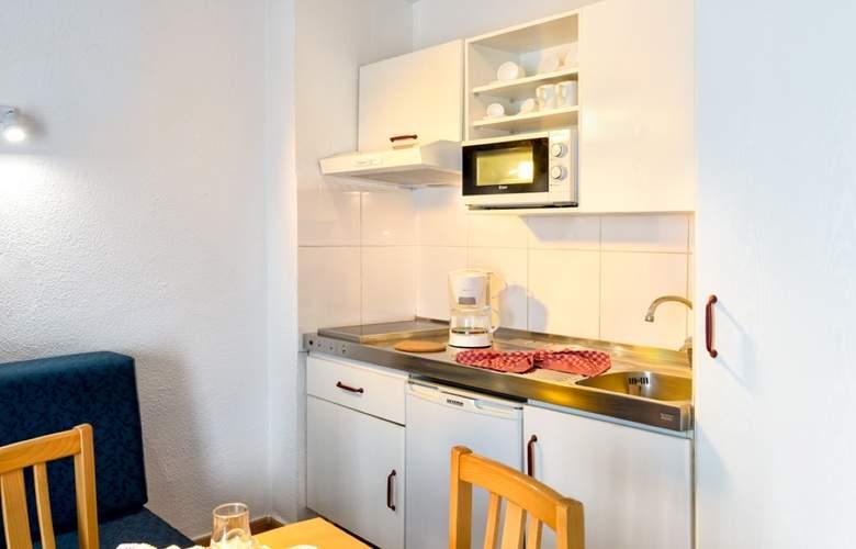 Oro Blanco Apartments - Room - 16