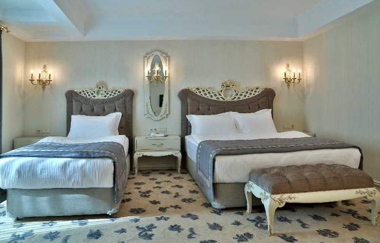 Cassiel Boutique Hotel - Room - 9