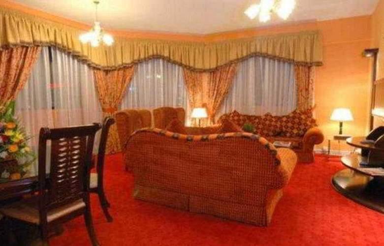 Al Jawhara Hotel Apartments - Room - 5