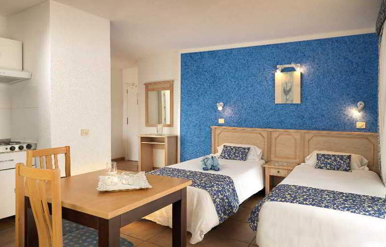 Oro Blanco Apartments - Room - 2