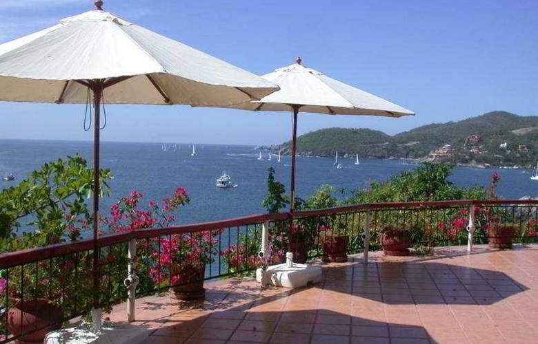 Catalina Beach Resort - Terrace - 9