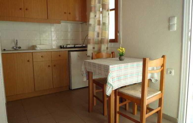 Haris Apartments - Room - 6