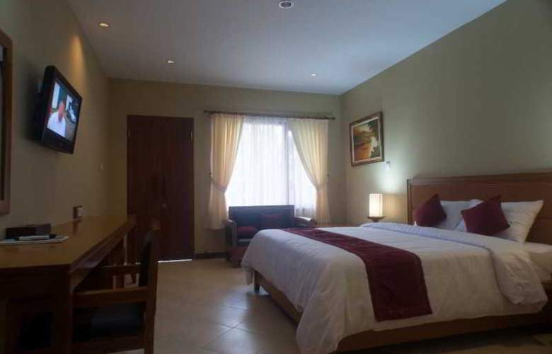 Kuta Puri Bungalow - Room - 10