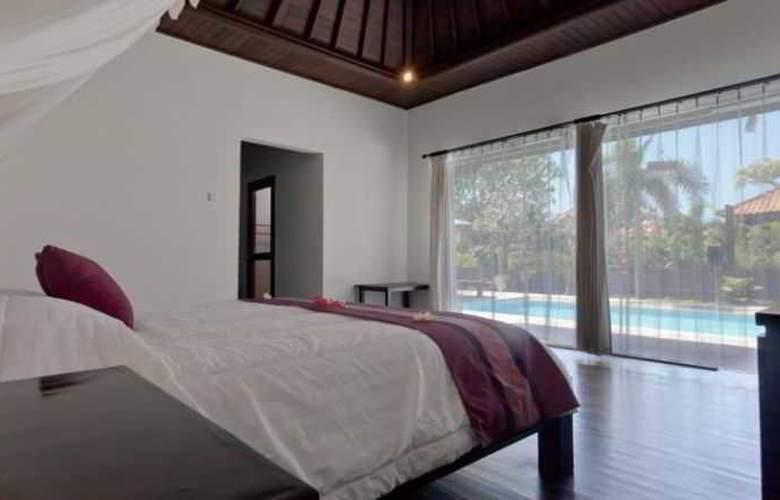 Adi Assri Beach Cottages Singaraja - Room - 12