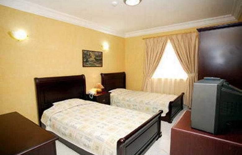 Al Mourouj Inn Hotel - Room - 0