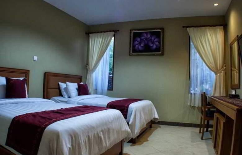 Kuta Puri Bungalow - Room - 11