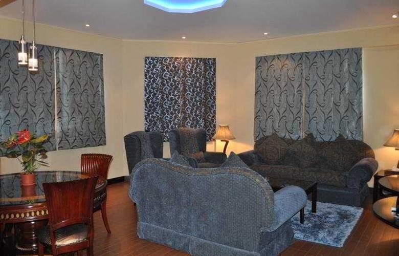 Al Jawhara Hotel Apartments - Room - 3