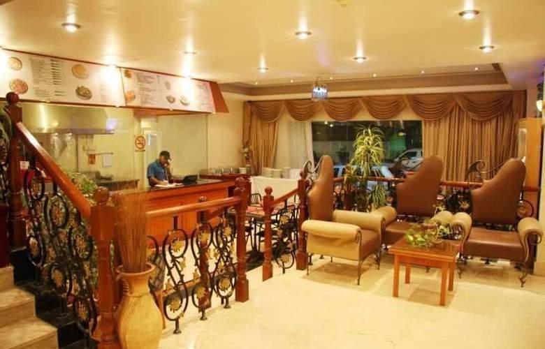 Ramee Hotel Apartments - Restaurant - 3