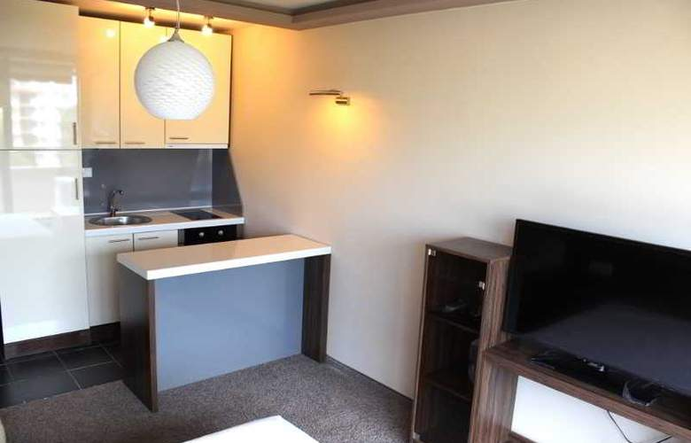 Boomerang Apartments - Room - 9